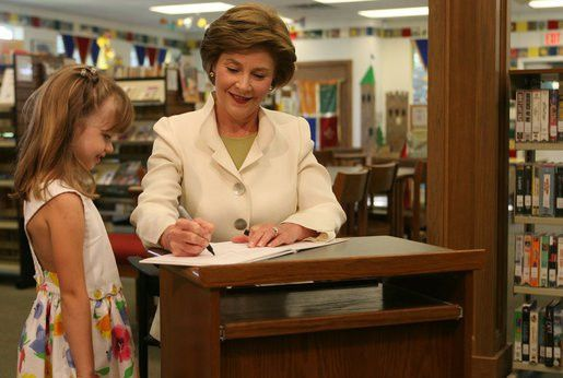 Five-year-old Reese, granddaughter of the head librarian, watches ...