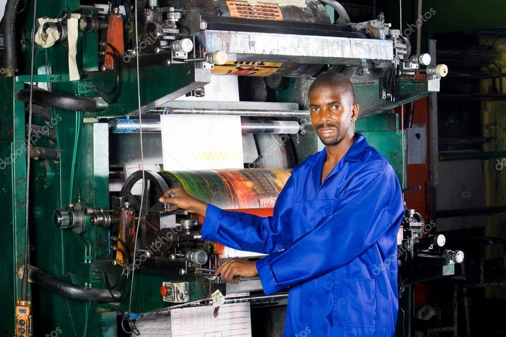 African printing press operator in factory — Stock Photo ...