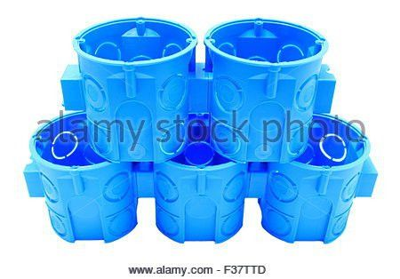 Stack of blue plastic electrical boxes on white background ...