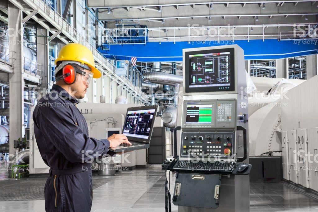 Engineer Using Computer For Maintenance Equipment In Powerhouse ...