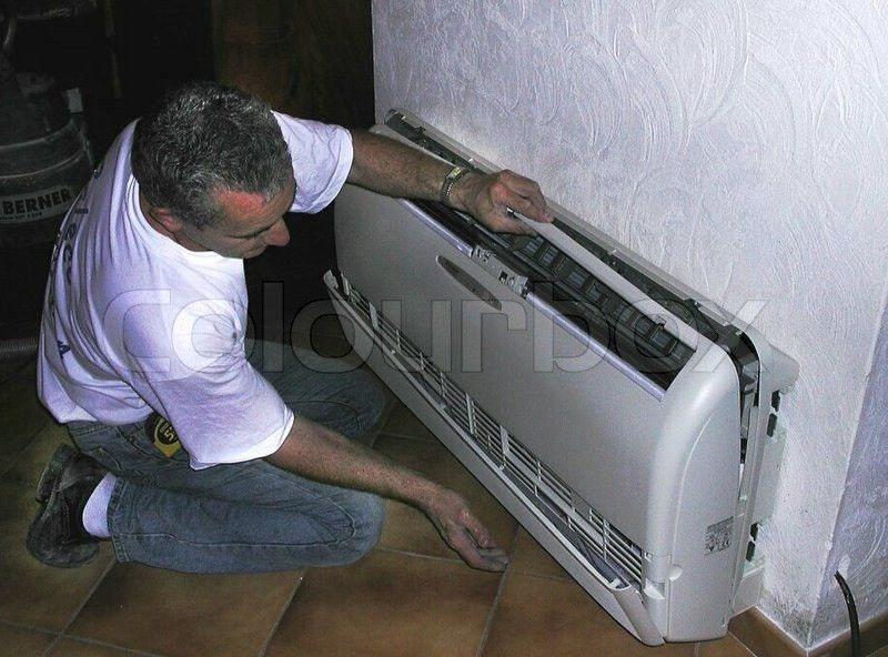 View of ac mechanic working on air conditioner | Stock Photo ...