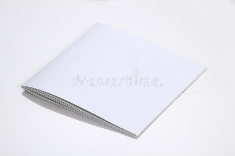 Folded White Blank Brochure Magazine Cover For Mock Up Stock Photo ...