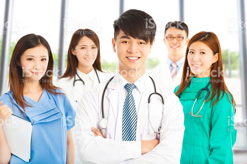 Professional Medical Doctor Team Standing In Clinic stock photo ...