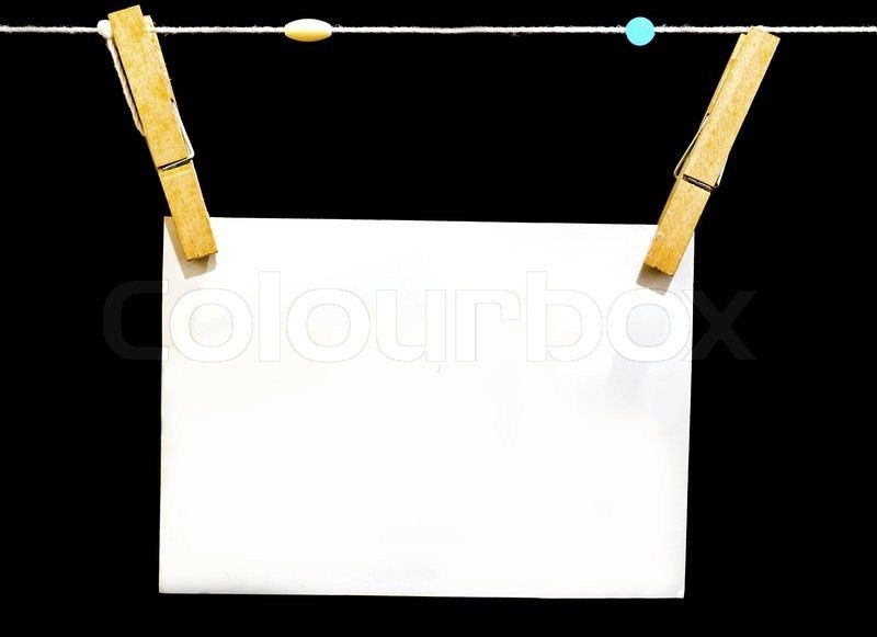 Blank paper with wood clip isolated on black background | Stock ...