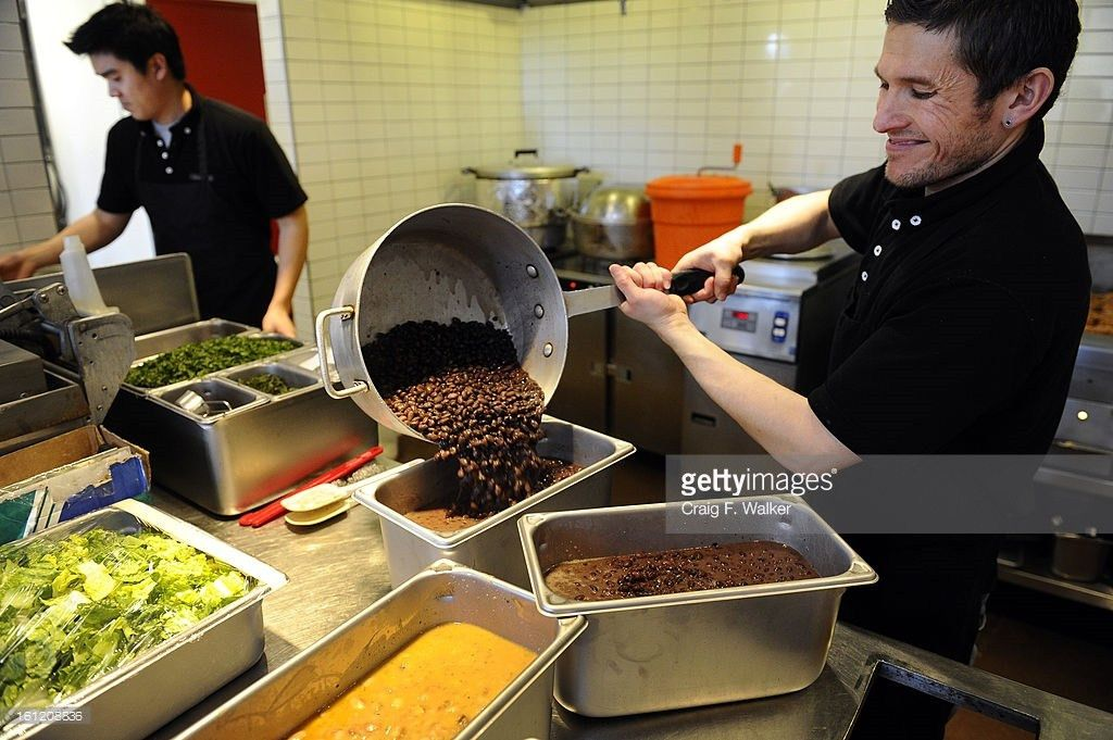 Kitchen manager Raul Ramos prepares food before opening at a ...