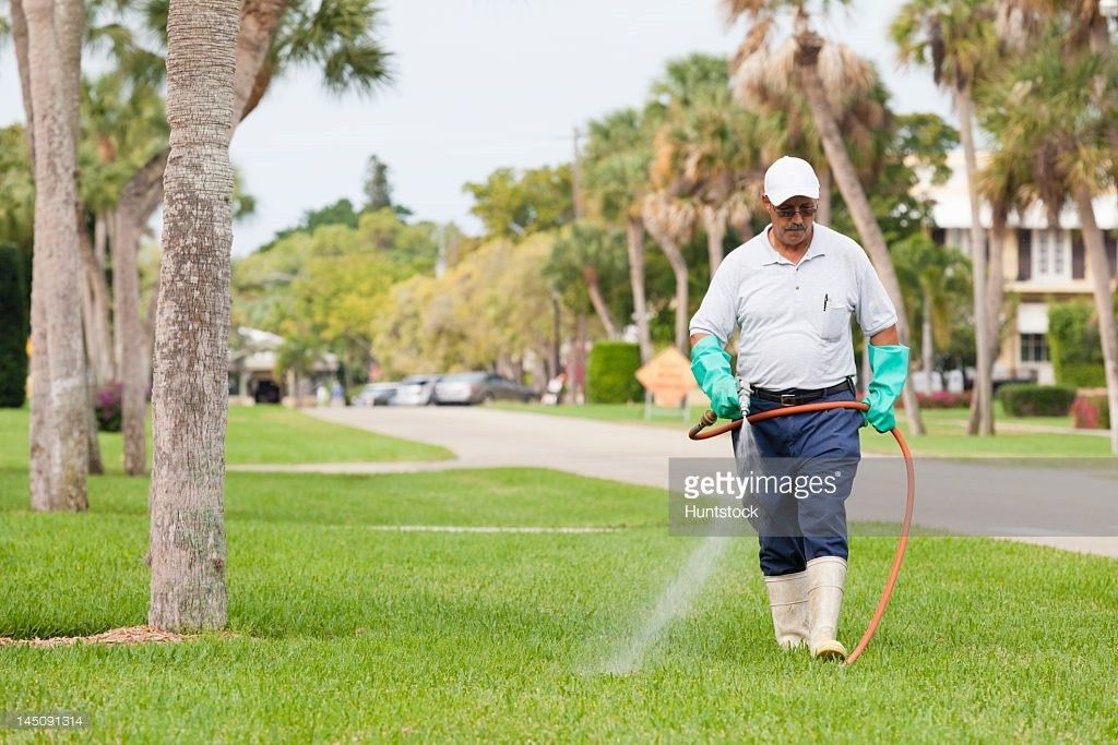 Pest Control Technician With Portable Spray Rig Using Spray Nozzle ...