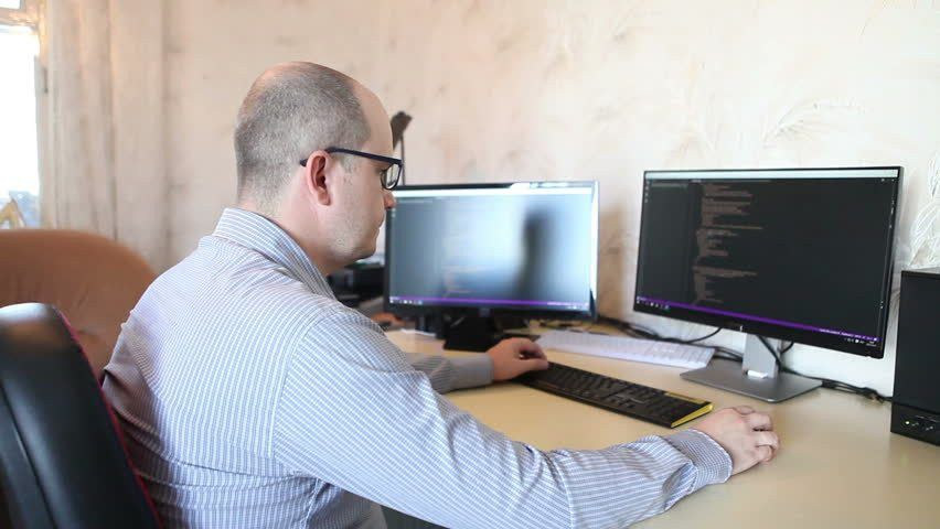 Freelance Programmer Working On Software Code Sitting At The ...