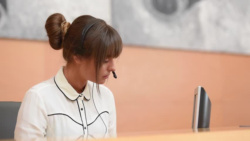 Receptionist At Front Desk With Headset On Stock Footage Video ...