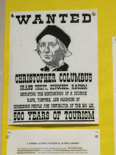 CRIMINAL: Prof. bashes Christopher Columbus with wanted poster