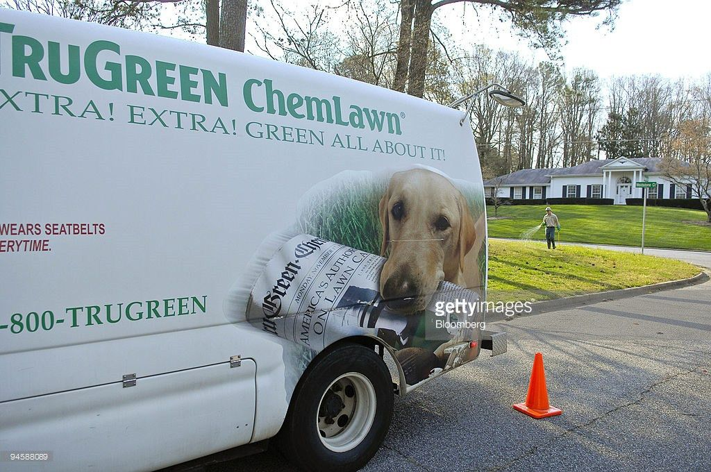With his TruGreen ChemLawn truck parked in the foreground, a ...
