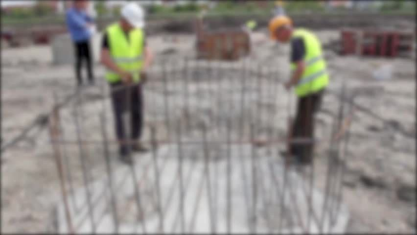 Rebar Tying. Blurred View On Workers Until They Are Placing The ...