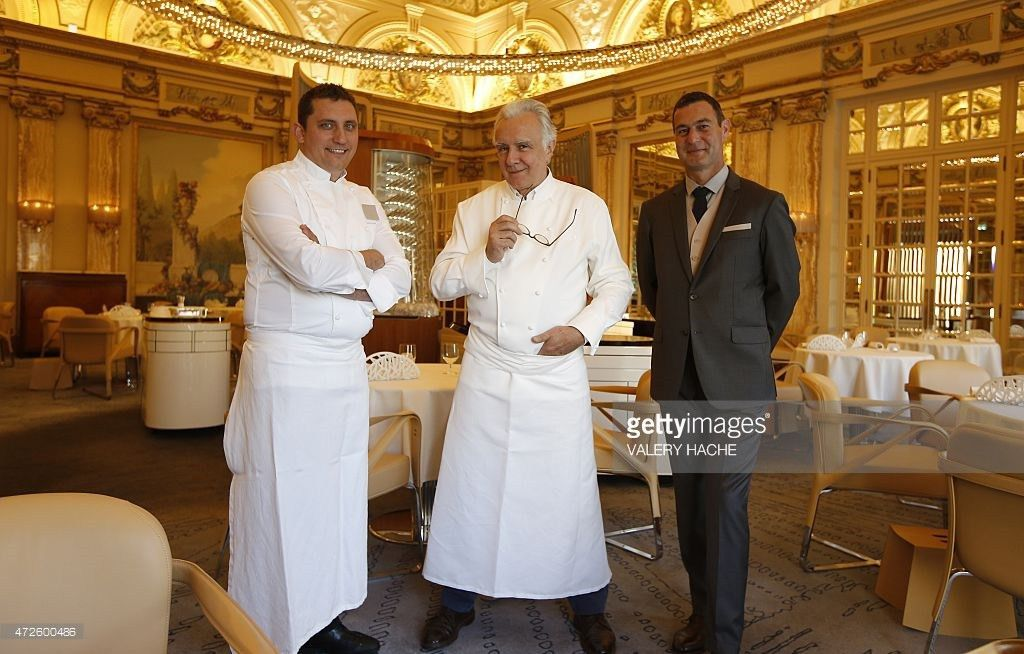 French chef Alain Ducasse (C) poses with kitchen manager Dominique ...