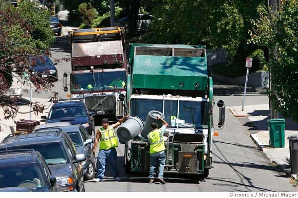 SOMEONE'S GOTTA DO IT / A TOUGH JOB: Substitute trash crews seen ...
