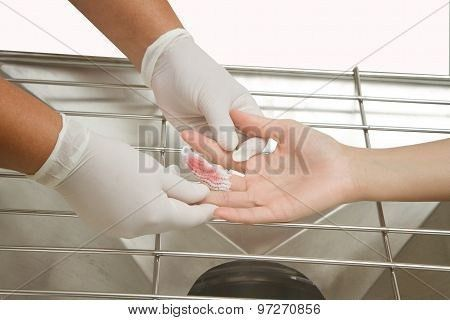 Medical Assistant Changes The Dressing Of A Wound At The Emergency ...