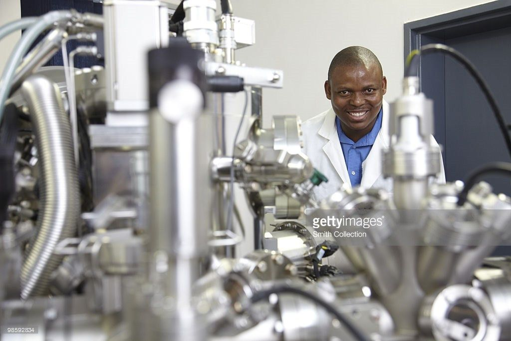 Chemical Analyst With A Surface Analysis Machine Stock Photo ...
