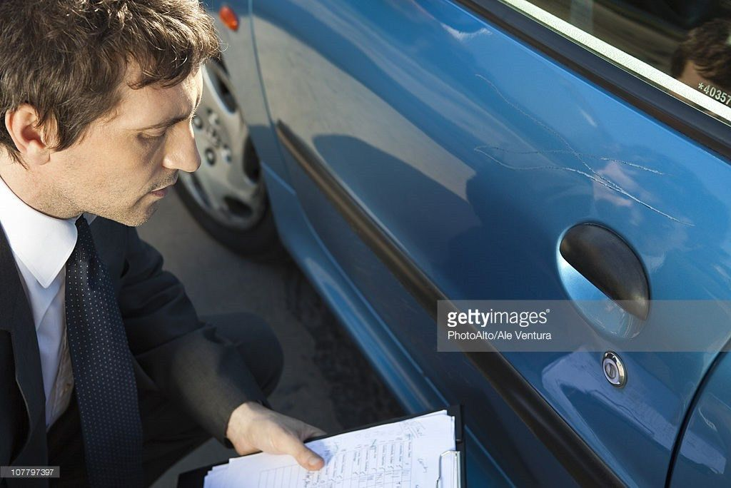 Insurance Adjuster Examining Damage To Car Exterior Stock Photo ...