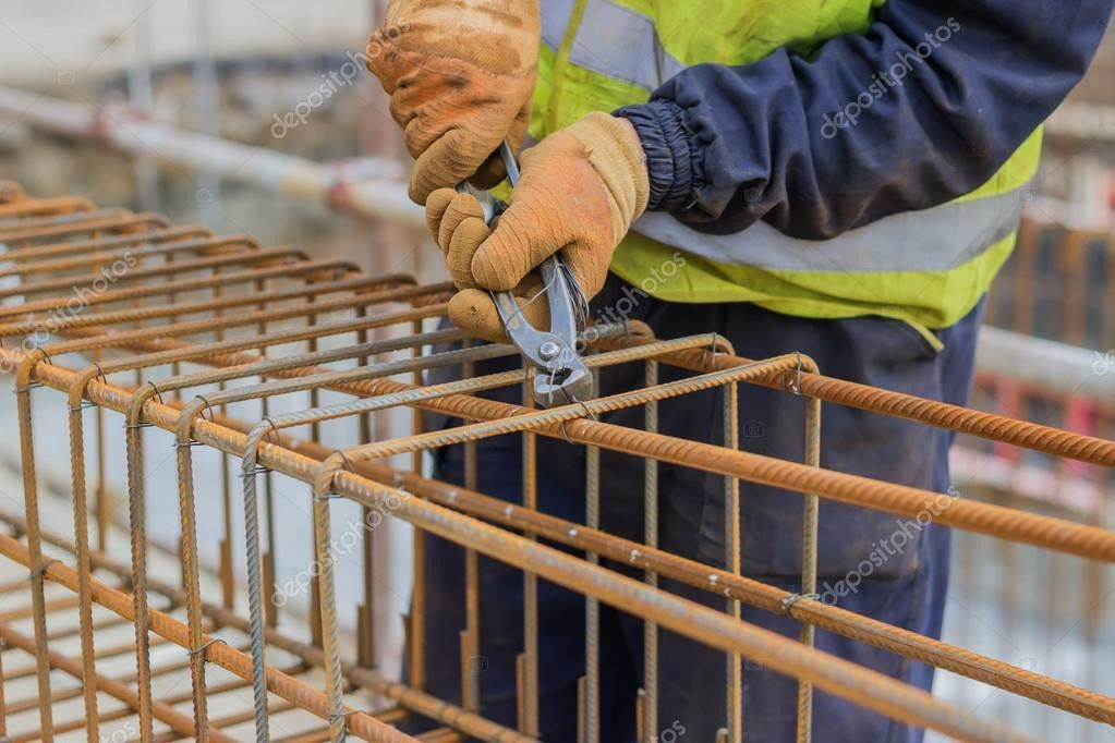 Workers hands using steel wire and pincers to secure rebar — Stock ...