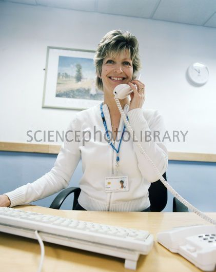 Hospital receptionist - Stock Image M520/0187 - Science Photo Library