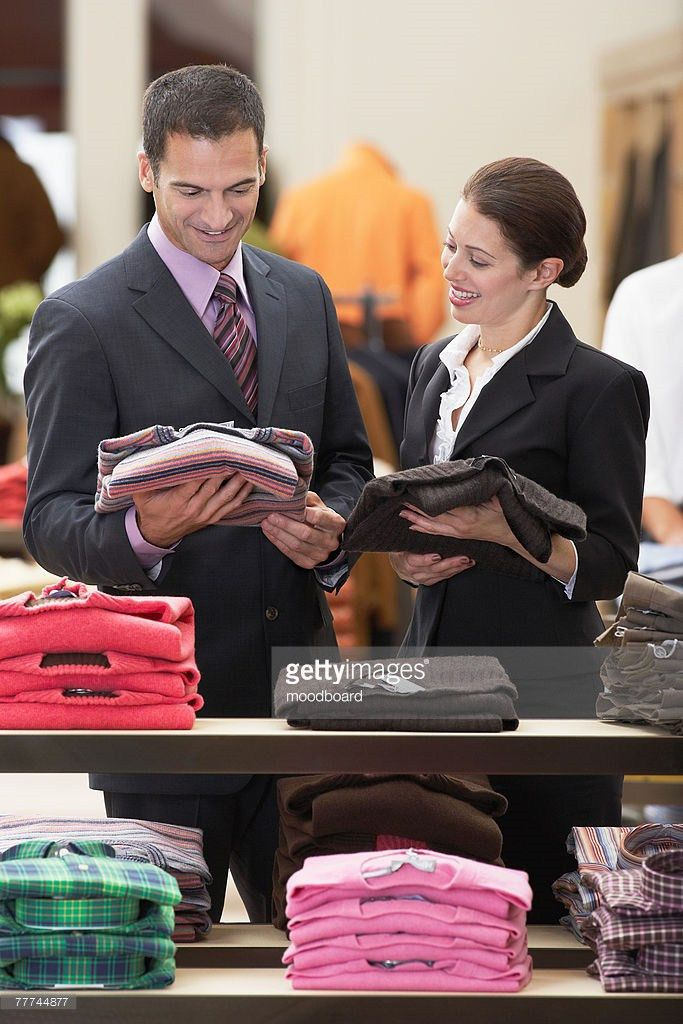Salesperson Helping Businessman In Clothing Store Stock Photo ...