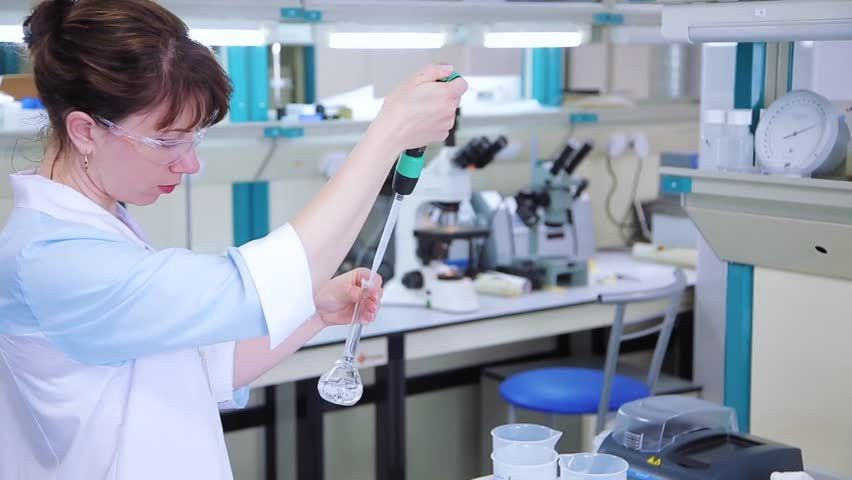 Chemistry Scientist Team Working With Tablet Pc. Chemist Woman ...