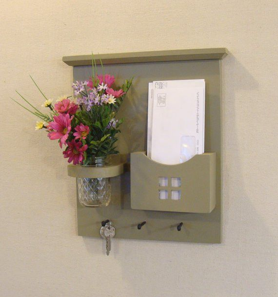 With a place to hang your keys, a wide mail slot for letters and 3 ...