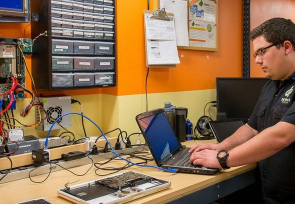 computer repair san diego. computer repair technician using laptop ...