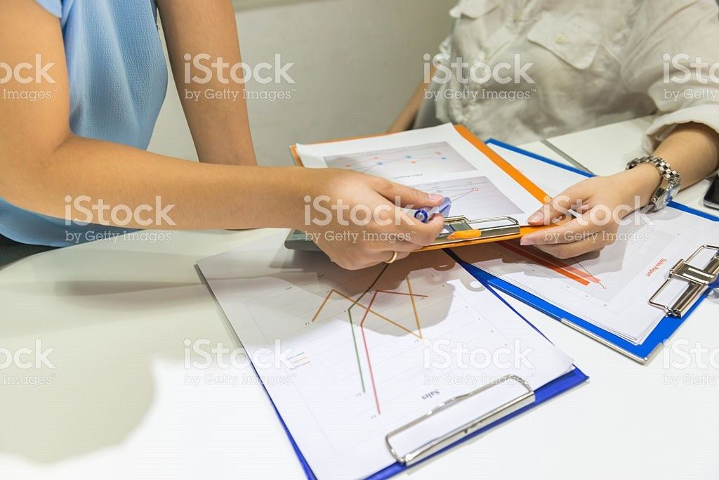 Asian Boss Checking The Sales Reports In Business Room Pictures ...