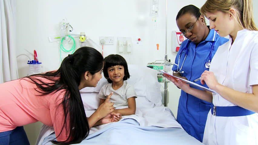 Pediatric Nursing Staff Checking Medical Charts Young Female Child ...