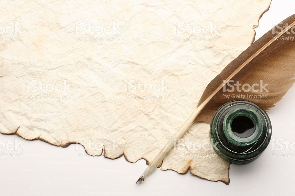Quill And Inkwell On Top Of Old Blank Document stock photo ...