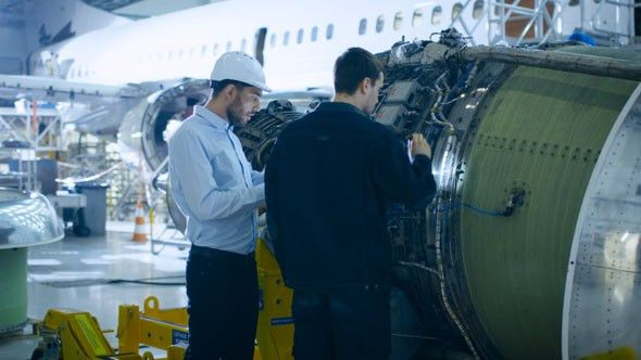 Aircraft Maintenance Engineer and Mechanic Inspecting and Working ...