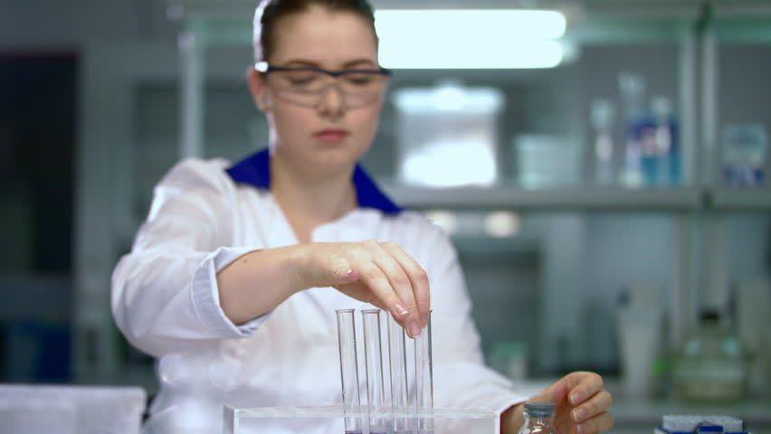 Scientist Team Working In Lab. Scientist Discussing Liquid Sample ...