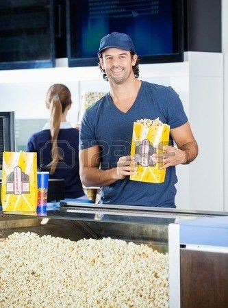 cinema concession male men popcorn selling stand worker ...