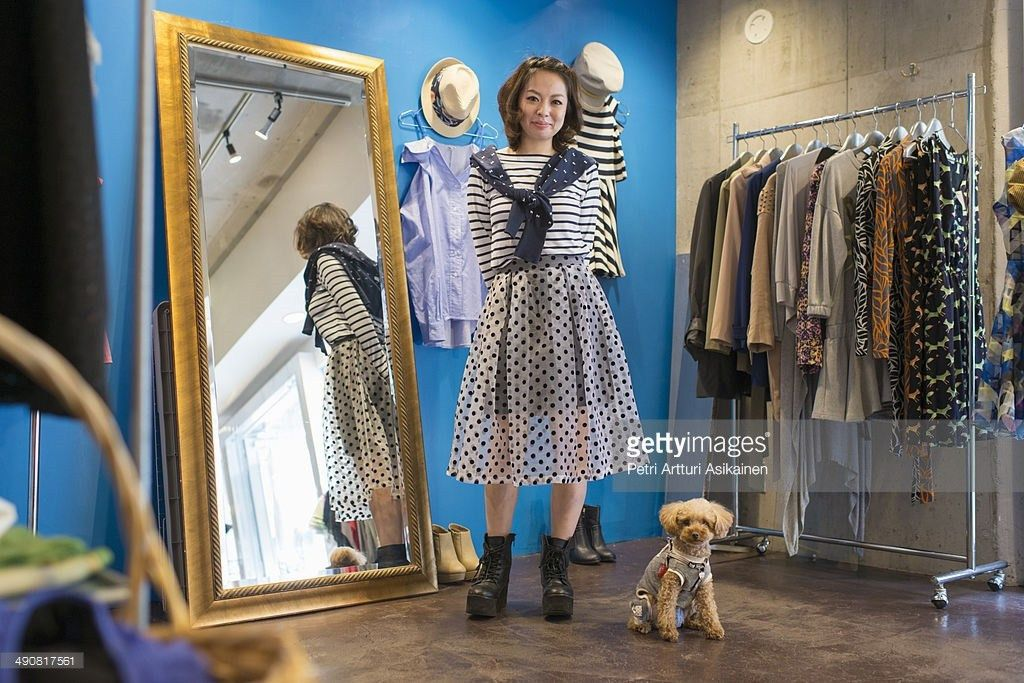 Female Salesperson With Dog At Clothing Store Stock Photo | Getty ...