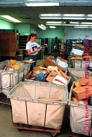 released woman postal worker sorting mail at post office Stock ...