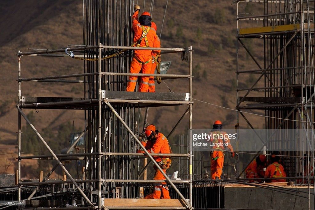 Construction Workers On Scaffolding Making The Reinforcing Steel ...