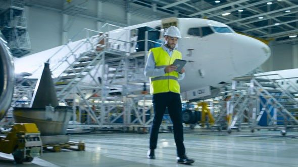 Aircraft Engineer in Safety Vest Walking Through Aircraft ...
