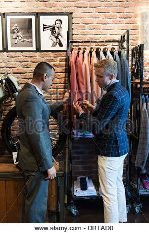 customer and salesperson, Stitched Men's Clothing Store Stock ...