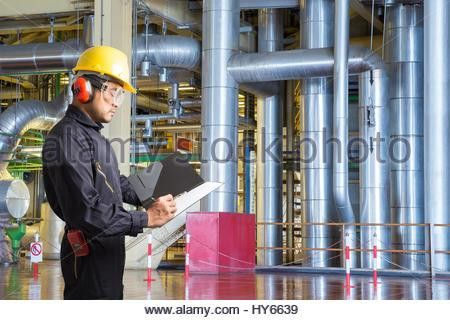 Engineer taking notes for maintenance work in thermal power plant ...