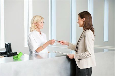 Receptionist in hospital Stock Photos - Page 1 : Masterfile