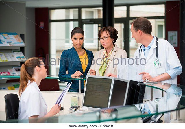 Medical Receptionist Computer Stock Photos & Medical Receptionist ...