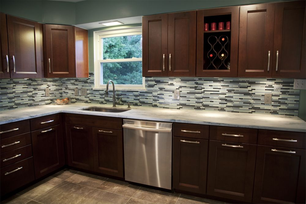 Gray wood floors warm cherry cabinets white counters for Floor kitchen cabinets