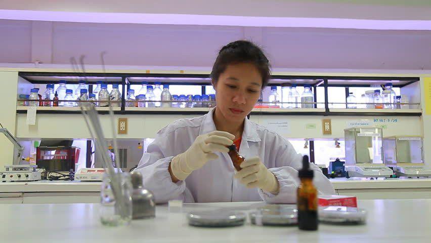 A Woman Chemist Or Laboratory Technician Enters The Scene Where A ...