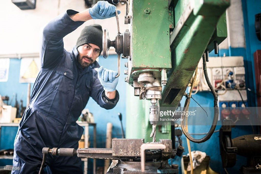 Industrial Engineer At The Lathe Machine Stock Photo | Getty Images