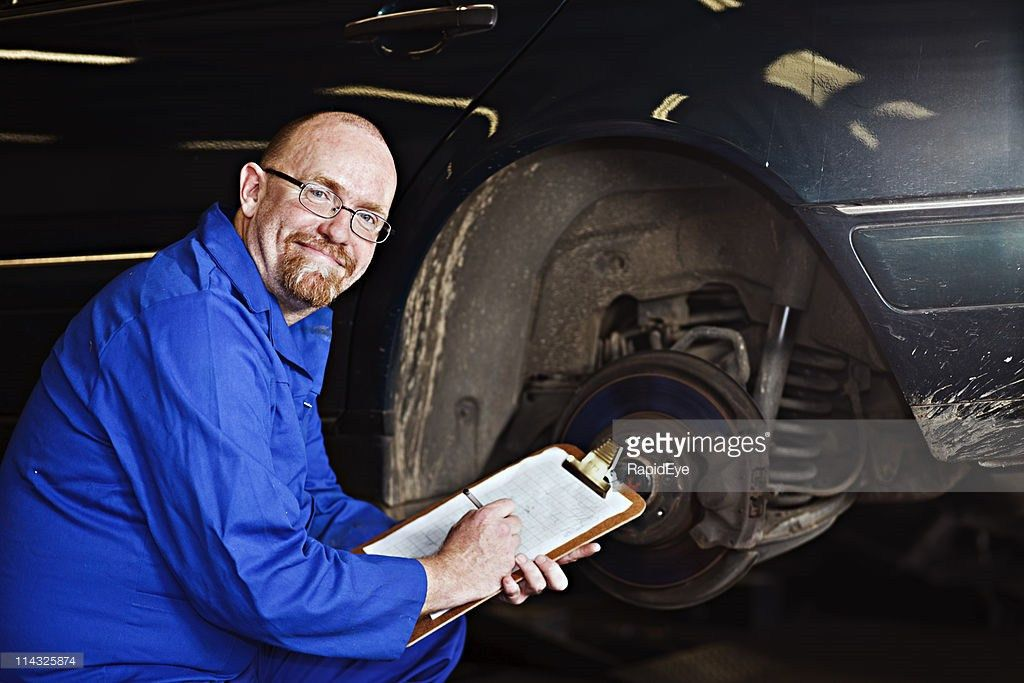 Smiling Auto Inspector Chief Mechanic Inspects Car Wheel Hub Stock ...
