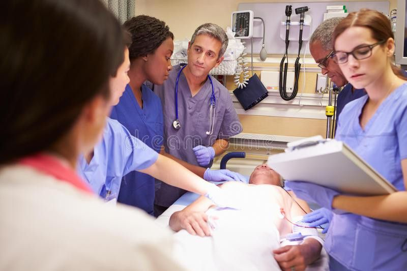 Medical Team Working On Patient In Emergency Room Royalty Free ...