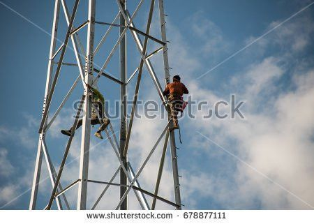 Five Construction Workers Building Metallic Scaffold Stock Photo ...
