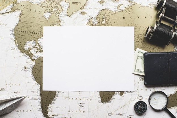 Blank paper with travel items and world map background Photo ...