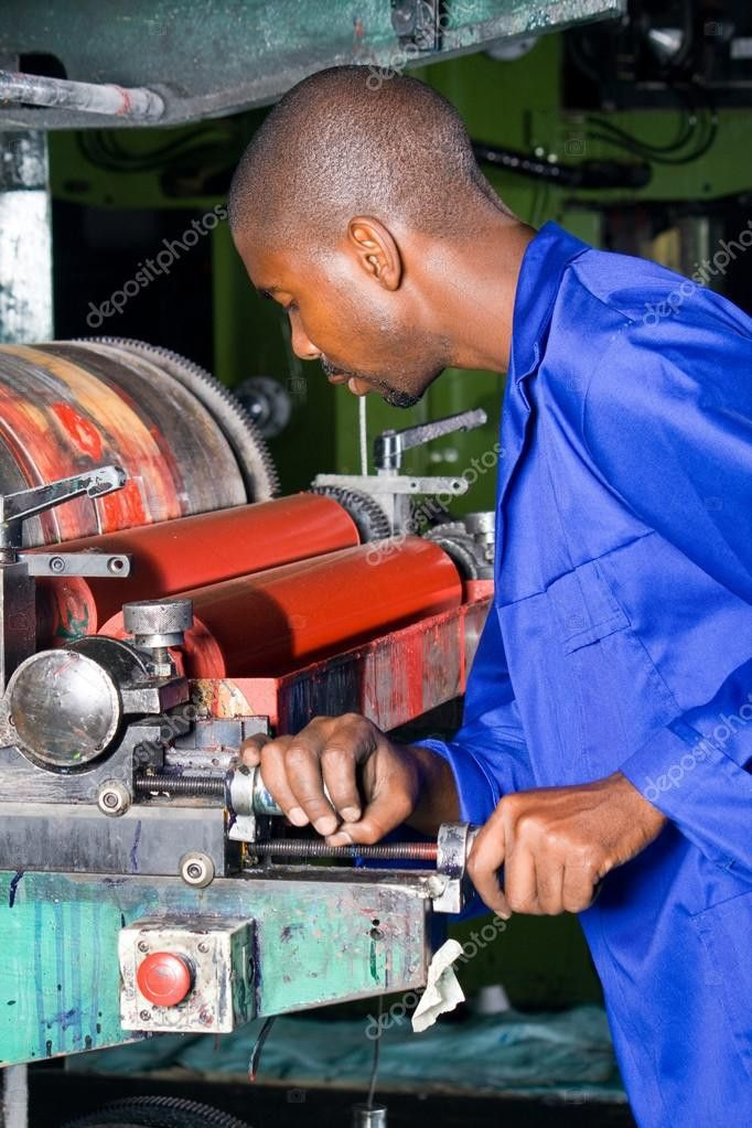 African printing press operator at work — Stock Photo ...