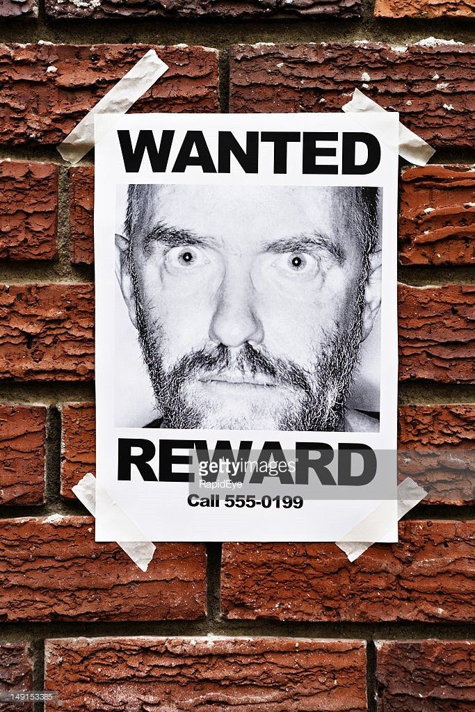 Mental Patient Or Criminal Wanted Poster On Brick Wall Stock Photo ...