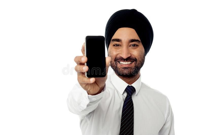 Salesman Displaying Newly Launched Mobile Phone Royalty Free Stock ...